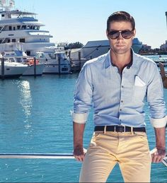 light blue pinstriped shirt. cream colored pants. dark brown belt. shades. cool. casual. summer. style.