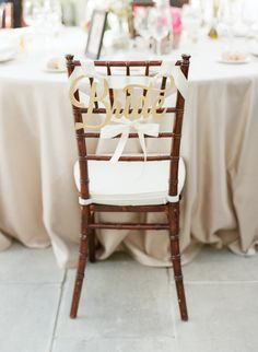 """Gold """"Bride"""" chair hanging: http://www.stylemepretty.com/2016/07/18/an-italian-wedding-thats-not-afraid-of-color/   Photography: Sophie Epton Photography - http://www.sophieepton.com/"""