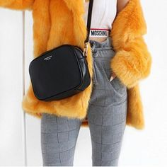 Pattern pants and yellow fur jacket