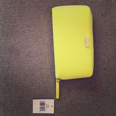 Kate spade wallet Beautiful. New with tags. Neon. Zip closure. Newbury lane collection. kate spade Bags Wallets