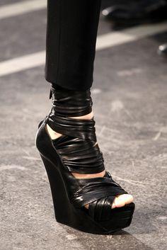 Black platform wedge sandals. Givenchy, Ready-to-Wear Spring 2010. Photo: Monica Feudi / GoRunway
