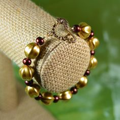 Get your shine on this season. Bright gold Czech glass melon beads are framed by smaller Indian bronze glass beads in this unique bracelet closed by a golden seahorse toggle clasp. A regal statement for evening or day. $15. Buy now at #SmallestPlanet.
