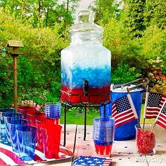 This layered American Flag concoction is destined to be a real crowd pleaser – and keep you free to enjoy the party. Layer pomegranate or cranberry juice or Italian soda with blue Gatorade and club soda and plenty of ice in a large beverage dispenser. Keep the layers from mixing by making sure the liquid with the highest sugar content is at the bottom. Complete your drink station with an ice bucket, red, white and blue tumblers, and beverage napkins.