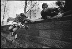 Mary Ellen Mark's legendary photographs – Girl jumping over a wall, Central Park, New York, 1967