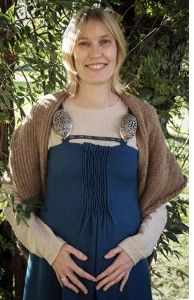 """Hilde Thunem's apron dress, or """"smokkr,"""" as some people believe it was called during the Viking age, based upon the Køstrup, Denmark, find. Note that this dress is also made from multiple pieces like the Hedeby-based dresses, but it has additional shaping from tiny pleats at the center front (the Køstrup piece was pleated). It's also worth noting that the pleats on this dress extend lower than on most recreations based upon the Køstrup find."""
