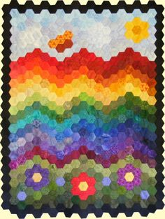 Sew Over the Rainbow free 'Members' quilt pattern. http://www.victorianaquiltdesigns.com/VictorianaQuilters/PatternPage/PatternPage.htm #quilting #hexies