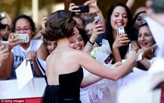 Lily Collins | Snap happy: The awaiting crowd was eager to get their own photos of the glamorous star...