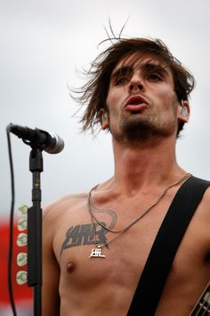 Tyson Ritter Ugh he broke the R off his necklace :(