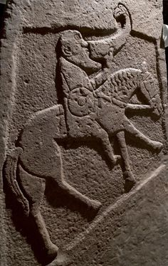 Viking age /Pictish sculptured stone slab depicting a horseman with sword and shield drinking from an ox horn, from Bullion, Invergowrie, Angus, c. 900 - 950