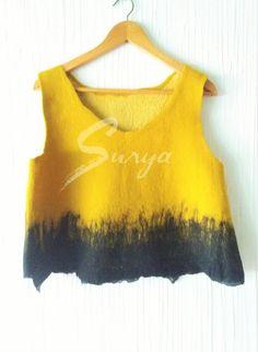 http://suryalanayseda.com/producto/top-de-lana-merino-color-mostaza-y-negro