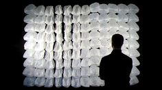 One Hundred and Eight is an interactive wall-mounted Installation mainly made out of ordinary garbage bags. Controlled by a microcontroller each of them is selectively inflated and deflated in turn by two cooling fans.   Although each plastic bag is mounted stationary the sequences of inflation and deflation create the impression of lively and moving creatures which waft slowly around like a shoal. But as soon a viewer comes close it instantly reacts by drawing back and tentatively following…