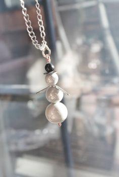 Snøwman made of fiber optic beads by Lisbethstafnedesigns on Etsy
