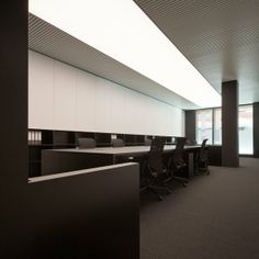 PBS office in Barcelona by Spanish architect Francesc Rife _great upper storage cabinets and cubbies