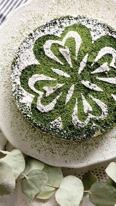 Recipe with video instructions: Take your tiramisu to the next level with yummy matcha. Ingredients: 2 slices sponge cake, 150g mascarpone cheese, 50g greek yogurt, 2 egg yolks, 40g sugar, 2 tsp rum, 150ml heavy cream, matcha powder, confectioners' sugar, (matcha syrup), 2 tsp matcha power, 1 tsp sugar, 100ml hot water