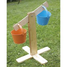 Outdoor Wooden Buckets and Scales Set Outdoor Wood Buckets and Scales Set Outdoor Learning Spaces, Kids Outdoor Play, Outdoor Play Areas, Kids Play Area, Backyard For Kids, Outdoor Games, Backyard Ideas, Preschool Playground, Backyard Playground