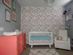 Noelle's Coral, Aqua and Grey Nursery with Gold accents. Stenciled Herringbone Wall, Monte Design Grano Glider Recliner, Hudson Crib from Babyletto.