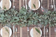 The head table will feature a runner of silver dollar eucalyptus with pillar candles in vases scattered throughout.