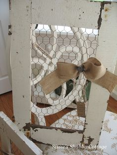 Sissie's Shabby Cottage: Finds that didn't ask for much   Old cabinet door and chicken wire...burlap bow