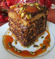 Someone make me this for my birthday please!! Pumpkin Turtle Cake: pumpkin sponge, layered with chocolate frosting, and covered in maple caramel sauce, toasted pecans and pumpkin seeds. Vegan!
