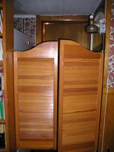 Swinging Bar Doors in the home. Had these between the kitchen and the living room so you couldn't look right into the kitchen from the front door...