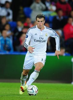 Real Madrid player Gareth Bale in action during the UEFA Super Cup match between Real Madrid and Sevilla FC at Cardiff City Stadium on August 12, 2014 in Cardiff, Wales.