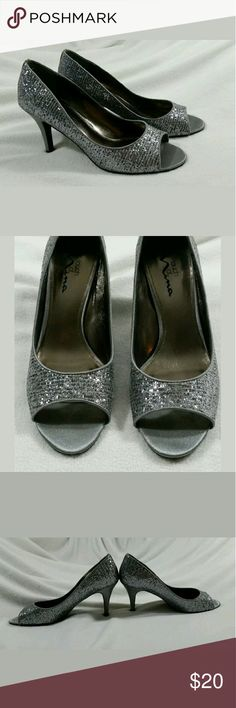 Women's Silver Sparkle Open Toe High Heels Size 9 Beautiful Touch of Nina Women's Open Toe High Heels  Size 9 M  Excellent Used Condition - no flaws found upon inspection and photographing  Smoke free, pet friendly Touch of Nina Shoes Heels