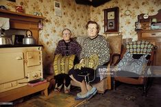 Two elderly women knitting Fair Isle style jumpers pose in the living room of a cottage on one of the Shetland Islands in June 1970.