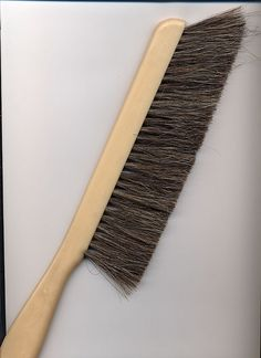 The drafting brush played an important role in the primitive production process. It ensured that the rubber erasure crumbs were kept clear of the working surface.