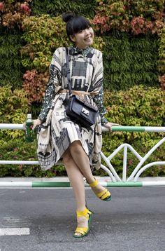 Susi Bubble in city-print ALPHA 60 dress over gem-print LIMEDROP blouse & studded MIU MIU bag.
