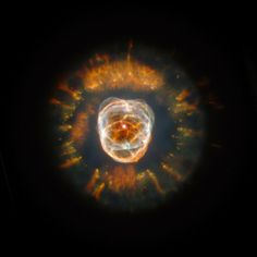 "This stellar relic, first spied by William Herschel in 1787, is nicknamed the ""Eskimo"" Nebula (NGC 2392) because, when viewed through ground-based telescopes, it resembles a face surrounded by a fur parka."