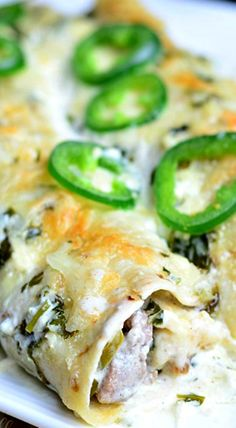 Steak Enchiladas with Jalapeno Cilantro Cream Sauce