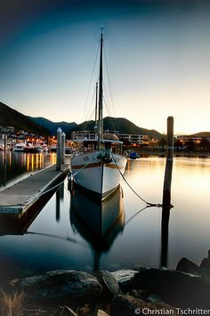Picton, New Zealand | Nestled on the coast of New Zealand's South Island sits this picturesque bay area frequented by many incoming and outgoing ships.