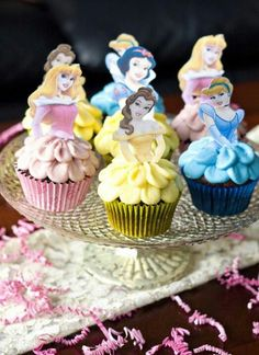 Disney Princess Cupcakes by rozthurman.sallee for a princess party. Paper cut outs with color printed princess's placed on top of cupcake that's iced and rippled as skirt and in appropriate color for individual princess. Cupcakes Princesas, Disney Princess Cupcakes, Princess Cakes, Disney Princess Birthday, Princess Theme, Dessert Oreo, Partys, Cookies Et Biscuits, Cute Cakes