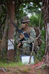 U.S. Marine with Company E, Battalion Landing Team, 2nd Battalion 4th Marines, 31st Marine Expeditionary Unit (MEU), listens to radio transmitions during a vertical assault as part of  the MEU Exercise (MEUEX), in Combat Town, Okinawa, Japan, Dec 10, 2014. BLT 2/4 is conducting training in preparation of their upcoming spring patrol. (U.S. Marine Corps photo by GySgt Ismael Pena/Released)