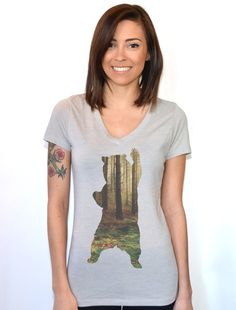 Bear V-neck T-shirt Womens Fashion Top Graphic Tee  Go for a walk in the woods and enjoy nature. Maybe you will even see a bear in this super soft fitted and hand printed with eco friendly ink graphic tee. This is a sublimation printed shirt and you can not feel the ink from the print. Hand printed with environmentally friendly ink on a super soft, fitted cotton/poly blend v neck.  Product Specifications Size Body Width Body Length  S 33 25 7⁄8  M 35 26 1⁄2  L 37 27 1⁄8  XL 40 27 3⁄4…