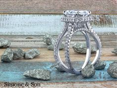 Radiant cut halo micro pave engagement ring with awesome criss cross shank.