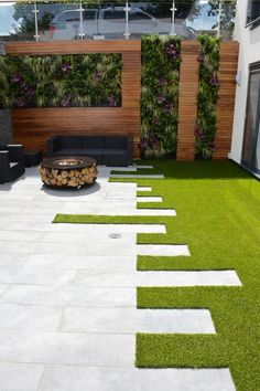 Check out the mind-blowing context of this garden decor idea. This garden is attractively settled with the vertical arrangement of the plants in between the wooden retaining wall. The patterns of the floor are made with marble infusion. This place seems perfect to enjoy cold winter nights while taking the pleasure of bonfire.