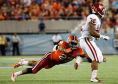 Robert Smith #27 of the Clemson Tigers attempts to tackle Samaje Perine #32 of the Oklahoma Sooners during the Russell Athletic Bowl at the Florida Citrus Bowl on December 29, 2014 in Orlando, Florida. (December 28, 2014 - Source: Sam Greenwood/Getty Images North America)