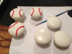 Baseball hand painted drawer knobs for a kids chest of drawers.