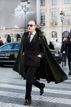 yup, he is rocking a cape. #thesartorialist