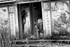 U.S. Marines of the 3rd Battalion, 4th Marines, crouch in the cover of a pagoda entrance 1967