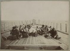 Men building a ship. The joints between the deck planks were filled or caulked with oakum to ensure better water resistibility. Estonia, ca 1900.