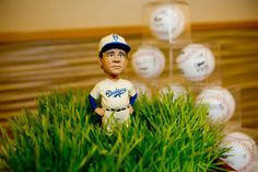 Dodger themed Bar Mitzvah luncheon, utilized our celebrants unique collection of bobbleheads for the centerpieces!  He also handed out autographed baseballs to his 'MVPs'
