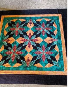 """There are still openings for my Northern Lights class at the AQS show in Grand Rapids in August. This is a student sample from one of my guild classes. It is NOT as hard as it looks. 8 point star with NO """"y"""" seams. Kaleido Star, Free Motion Quilting, My Books, Workshop, Student, Quilts, Blanket, Stars, Shop Ideas"""