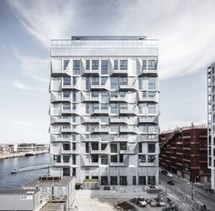 Galvanised-steel panels form balconies that cover the exterior of this former grain-storage silo, which COBE has converted into apartments in Copenhagen.