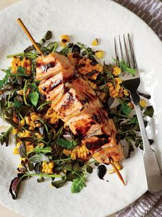 Gingered Salmon with Grilled Corn and Watercress Salad. Quinn Hatfield stuffs pickled ginger into slits in the salmon to infuse it with flavor. To keep the sliced fish intact and the ginger in place, he cleverly skewers the fillets before cooking.