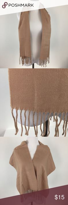 """Cashmere Camel Colored Scarf Wrap Cashmere camel colored / tan scarf / wrap. 100% cashmere. I removed the tag but you can see a similar tag of another cashmere scarf I'm selling. Very chic. Excellent used condition. Measurements: L 58"""" x W 12"""" with the strings. Last price. No offers. Accessories Scarves & Wraps"""