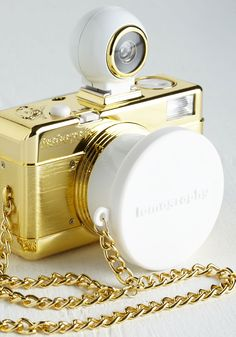 Fisheye No. 2 Camera in Gold. Shine like a star - whether youre in front of the lens or behind it - with this 35mm camera by Lomography! #gold #modcloth