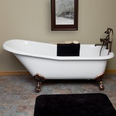 """Freestanding Cast Iron Clawfoot Tub...enough said! We love this 66"""" Goodwin tub. This #FithWallFriday is all about rustic finishes, warm tones, a traditional vibe, and Ceilume's Cambridge Ceiling Tiles. www.ceilume.com/"""