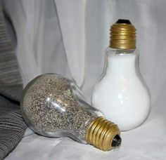 This pair of unique, up cycled Salt & Pepper shakers look wonderful in any home. They are the size of a normal light bulb. (3.5 x 2 inches) Both